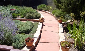 Flagstone path lined by chiseled rocks