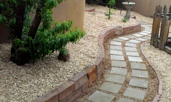 Curving  stone pathway with rock walls
