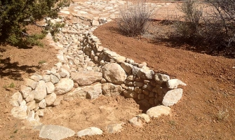 Using erosion control to protect driveway above