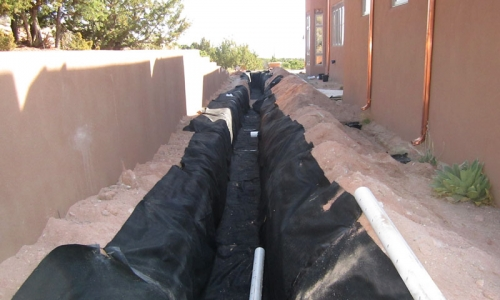 Pumice wick trench is lined with a geotextile fabric