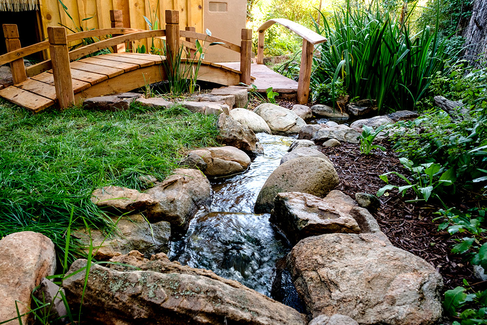 The Soothing Sounds Of Moving Water Come From A Bubbling Brook That  Recirculates 24 Hours A Day To Keep The Pond Clean And Healthy For Plants  And Wildlife.