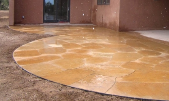 Curved flagstone patio provides interest