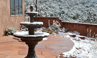 Flagstone patio in winter with fountain