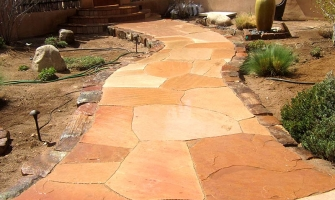 Flagstone walkway with moss rock border
