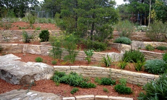 Terraces with rock walls and Xeriscape plants