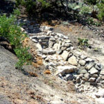 Stormwater Design Project for Flooding in Madrid, NM showing a One Rock Dam